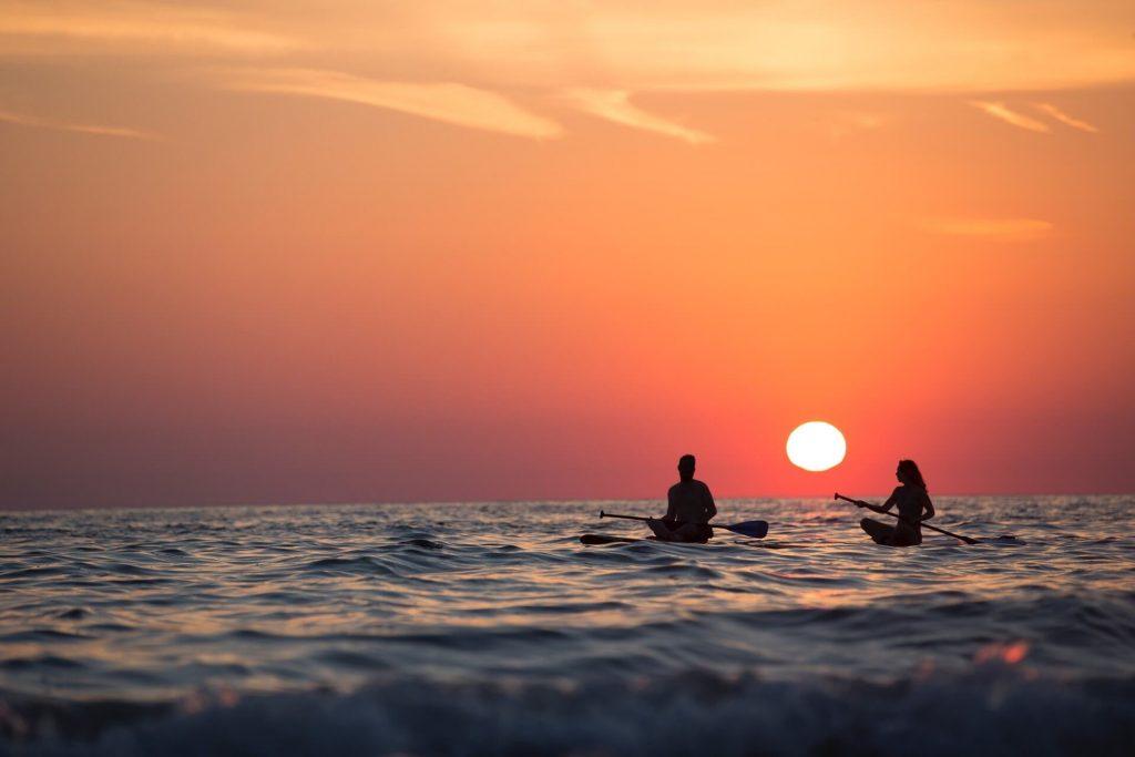 stand up paddle board world sunset