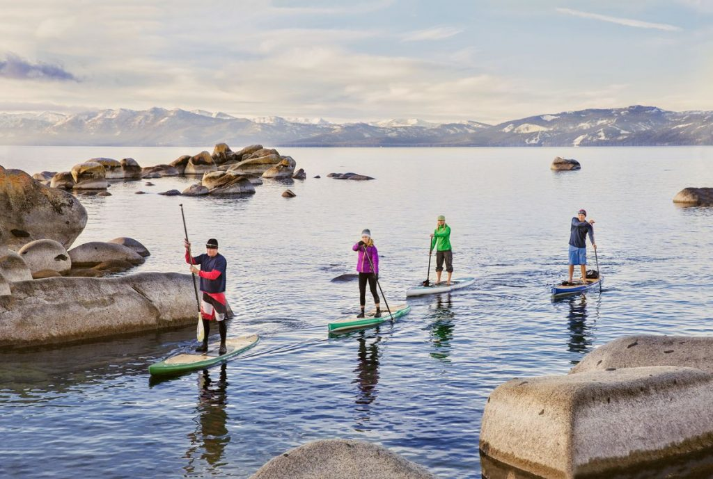 group paddleboarding in cold weather