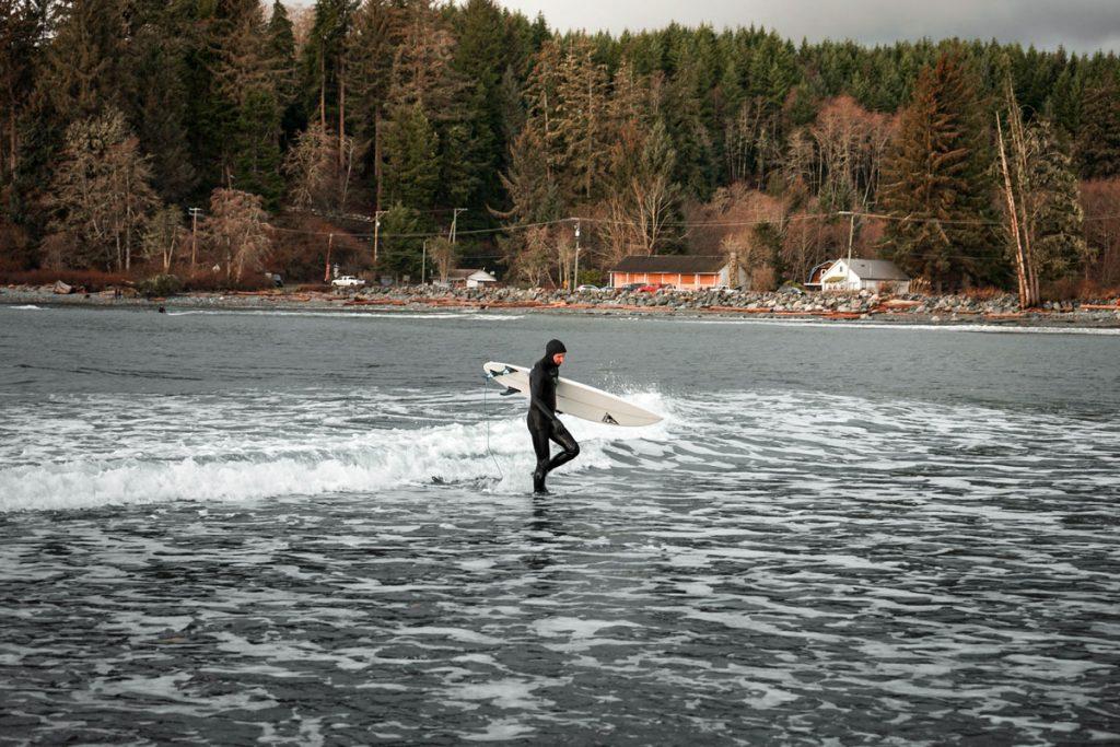 Man-Entering-Water-Wetsuit