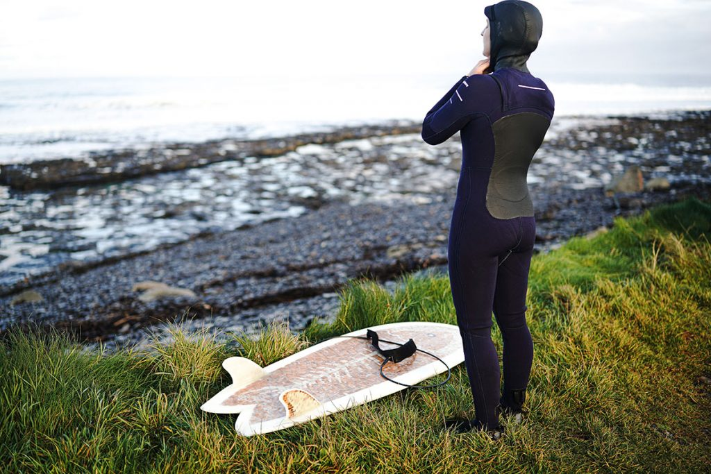 Man-Putting-On-Wetsuit