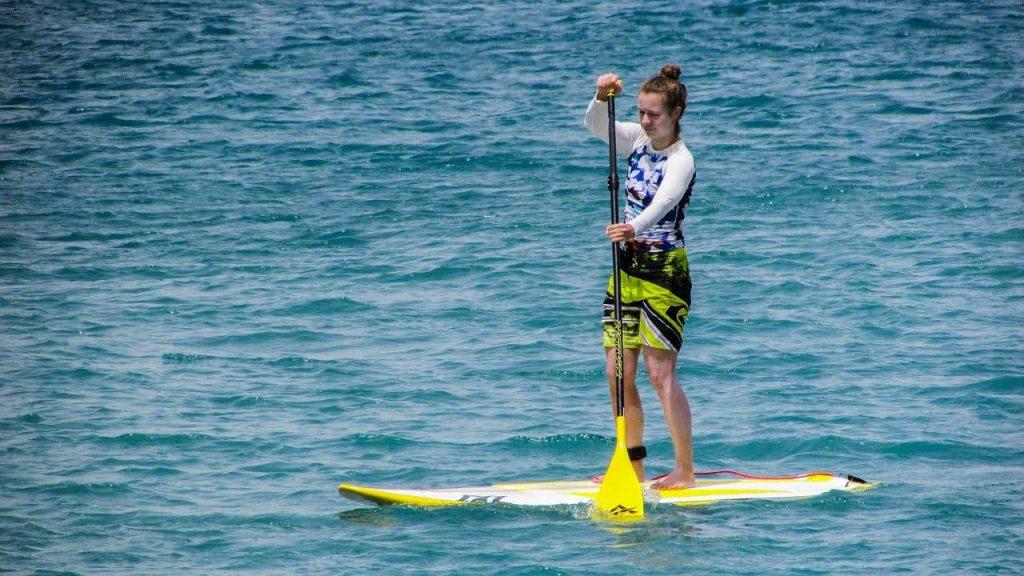 girl-paddling-hardboard
