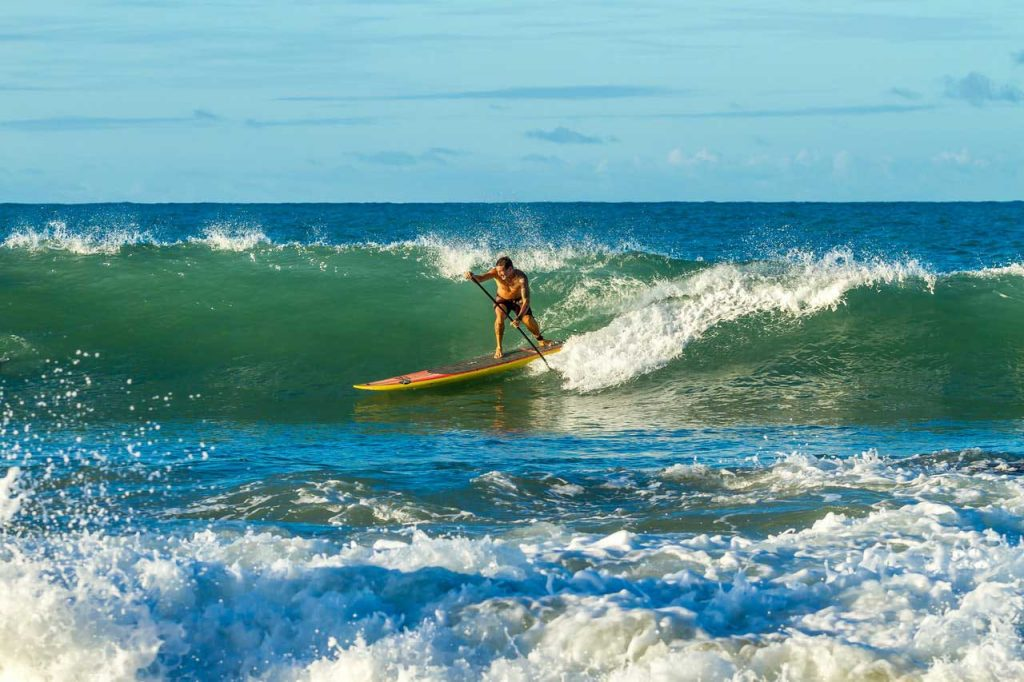 SUP-Surfing-Catching-Waves