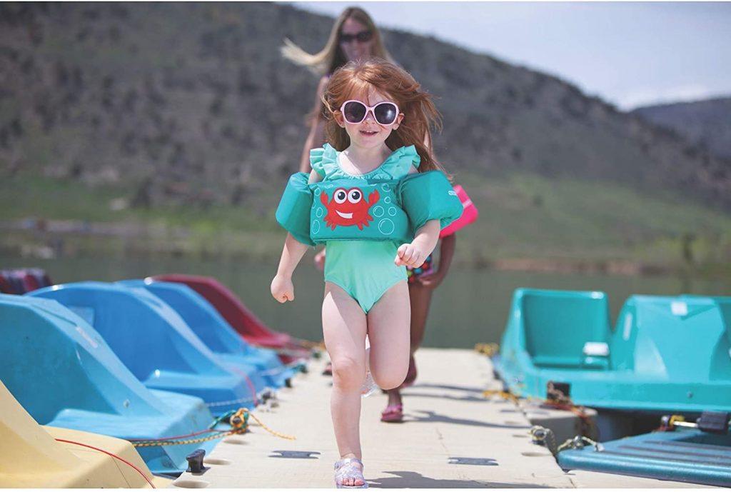 Girl wearing teal life jacket
