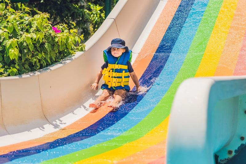 Boy wearing infant life jacket