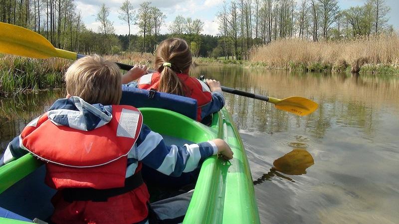 Kids on Kayak Wearing Life Jacket