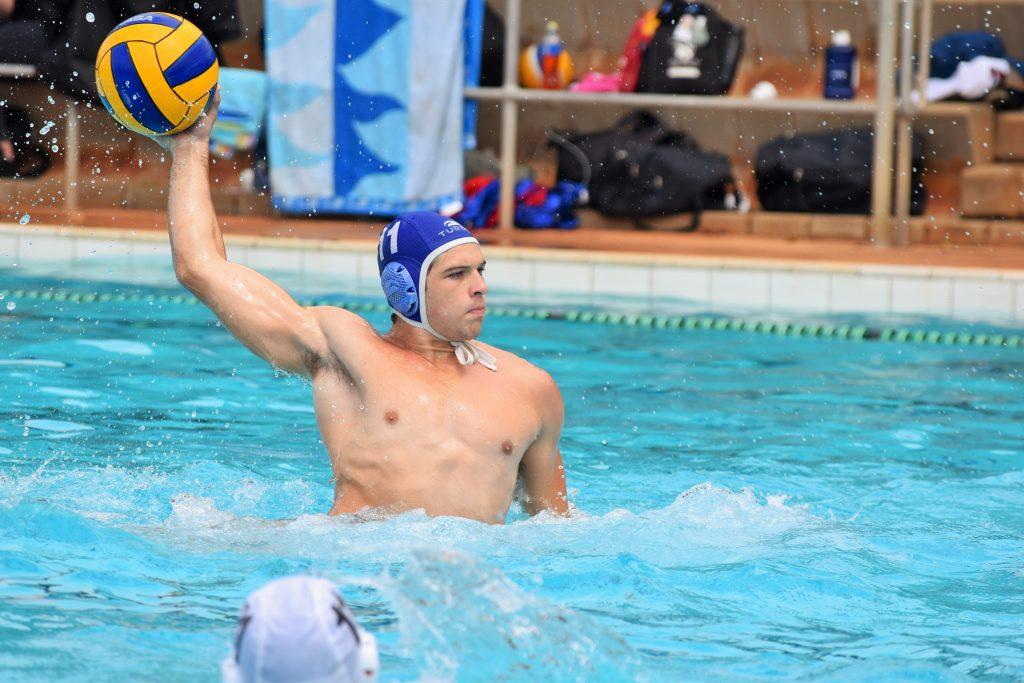 muscular man playing waterpolo